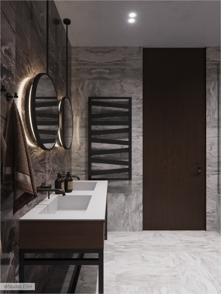 Bathroom in granite with round mirrors with lighting