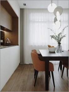 Dining area with cupboards from floor to selings