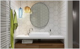 Oval mirror in the bathroom with lamps from Jeremy Pyles and Niche Modern collection