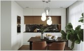Dining area in the kitchen-living room with a designer lamp
