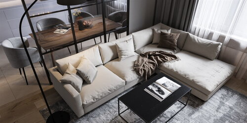 Big soft sofa in the living room with a designer table